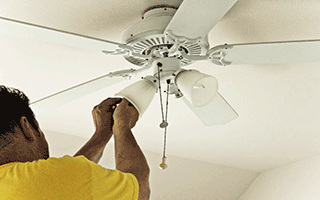 man-putting-light-in-house-fan